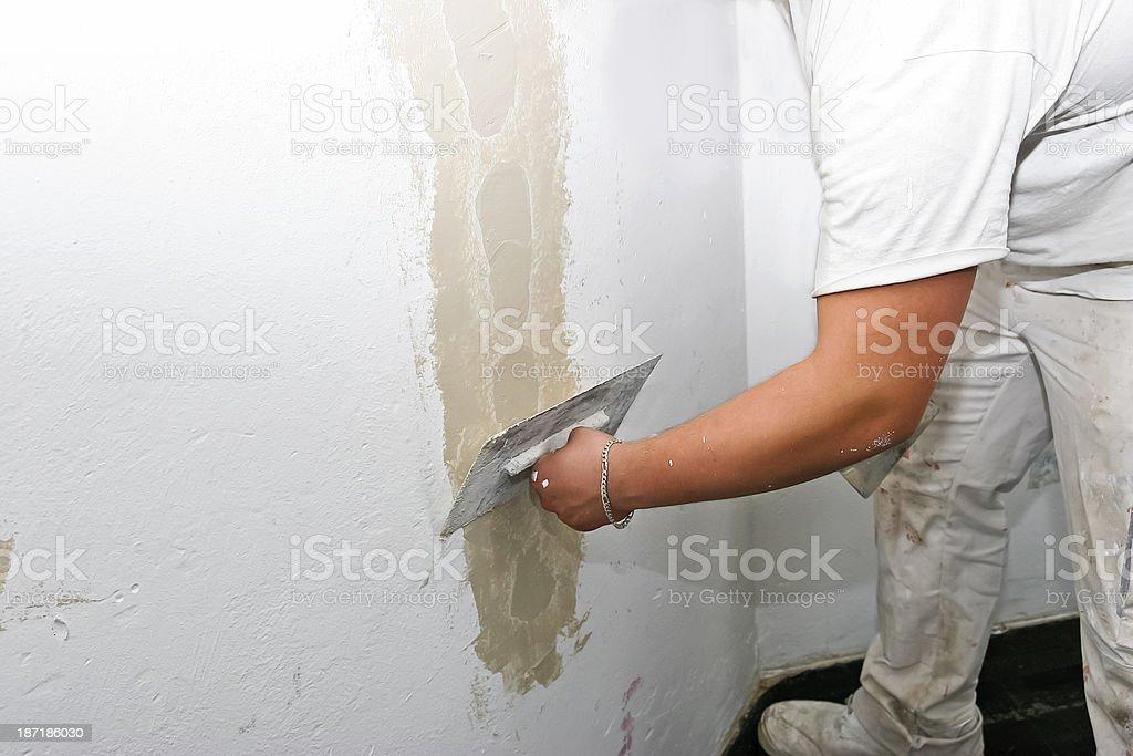 Plasterer Repairing Wall stock photo