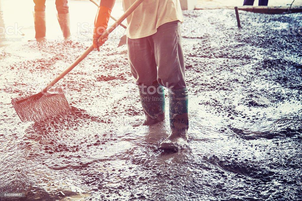 Plasterer screed concrete for floor in building stock photo