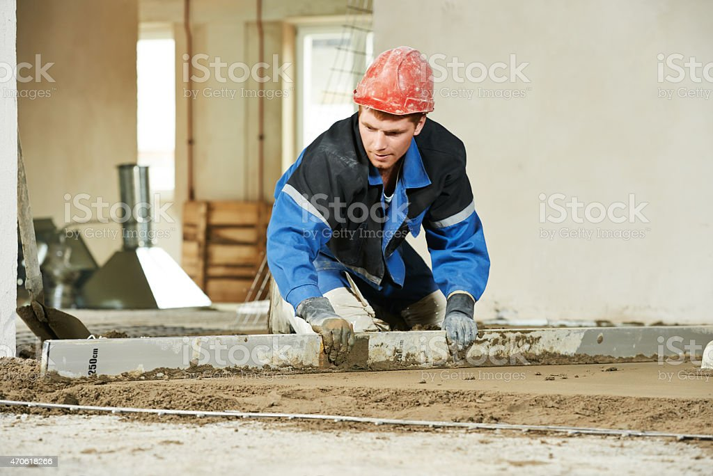 Plasterer worker at floor work stock photo