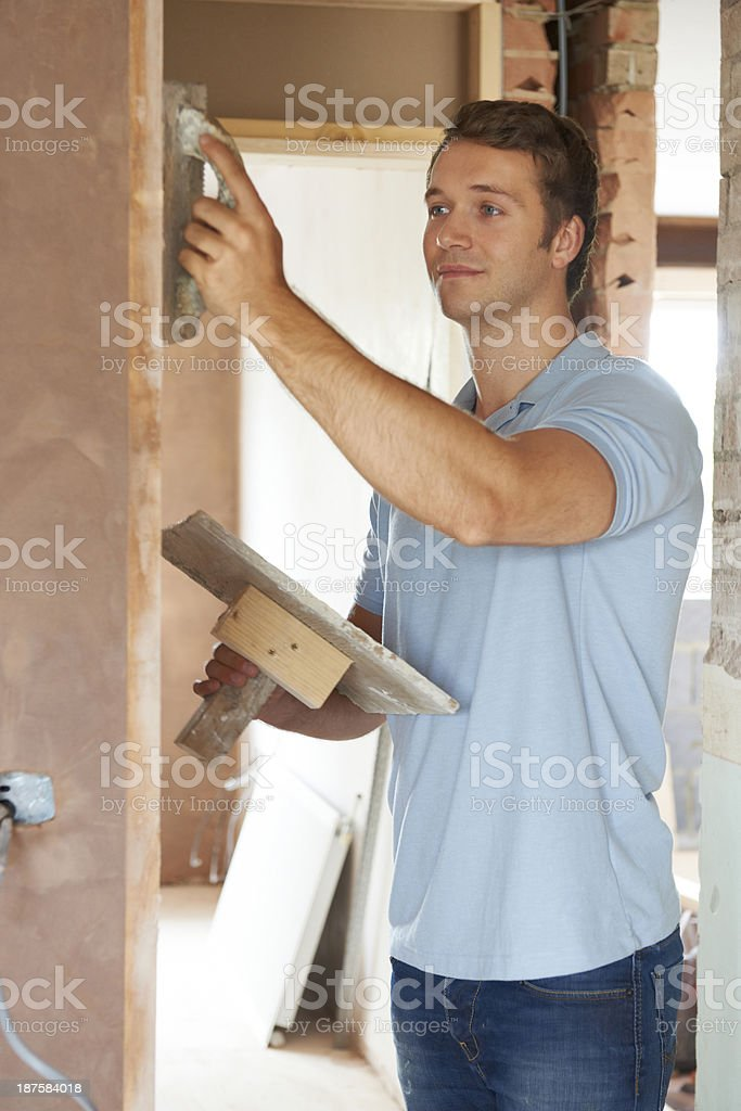 Plasterer Working On Wall royalty-free stock photo