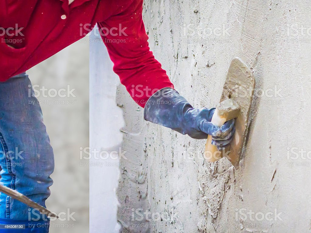 plastering mortar on the wall stock photo