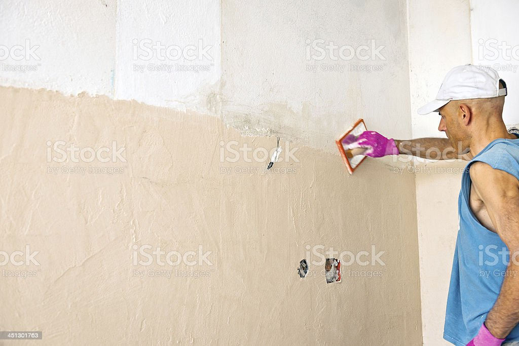 Plastering Wall during Home - Office Renovation royalty-free stock photo
