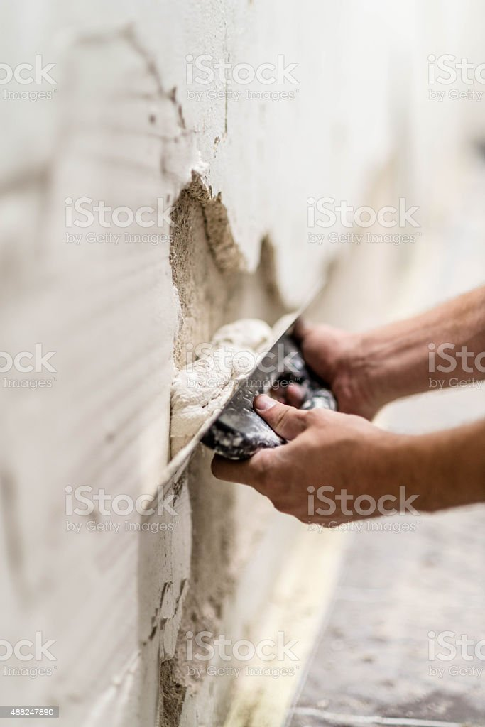Plastering wall stock photo