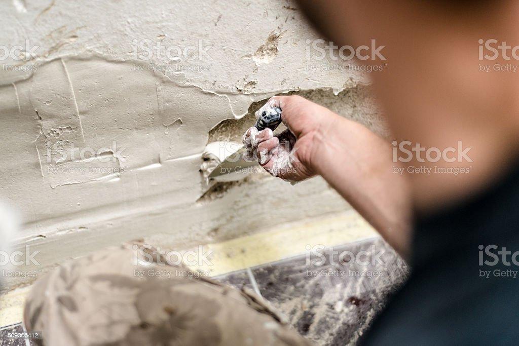 Plastering wall stock photo