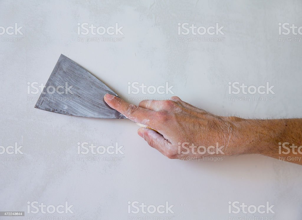 Plastering wall with plaste and plaster spatula trowel stock photo