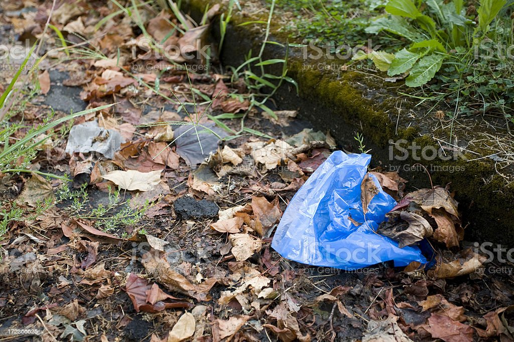 Plastic Bag littering the street stock photo