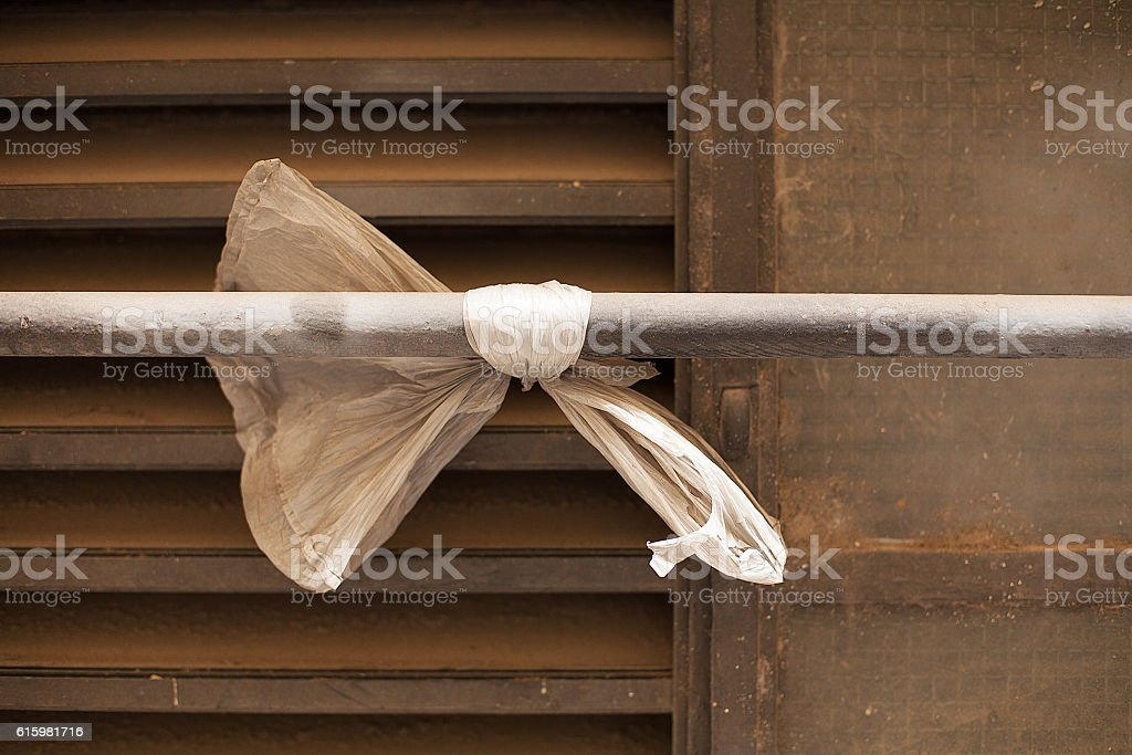 Plastic bag on pipe stock photo
