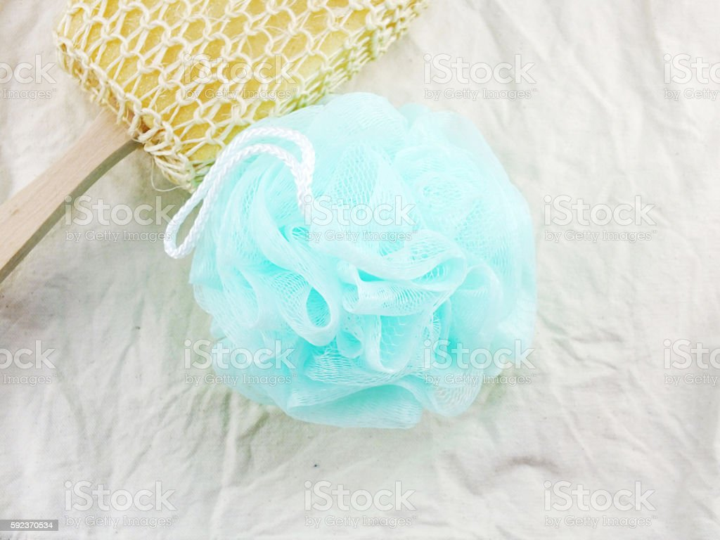 plastic bath puff and sponge for shower cleaning stock photo