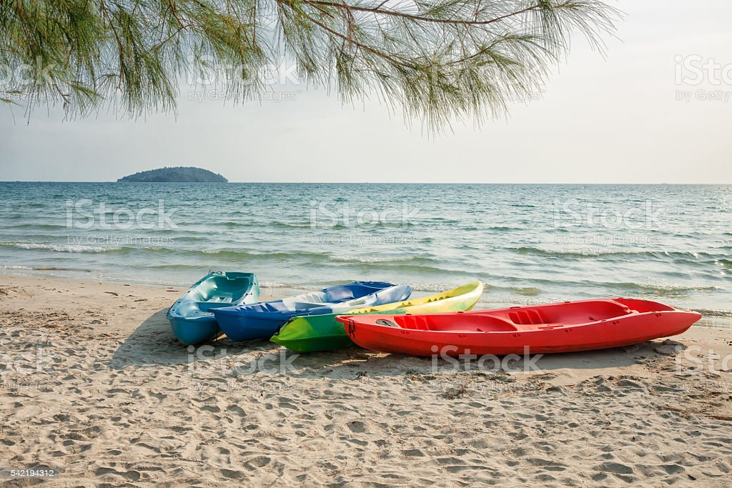 Plastic boat on a sandy beach stock photo