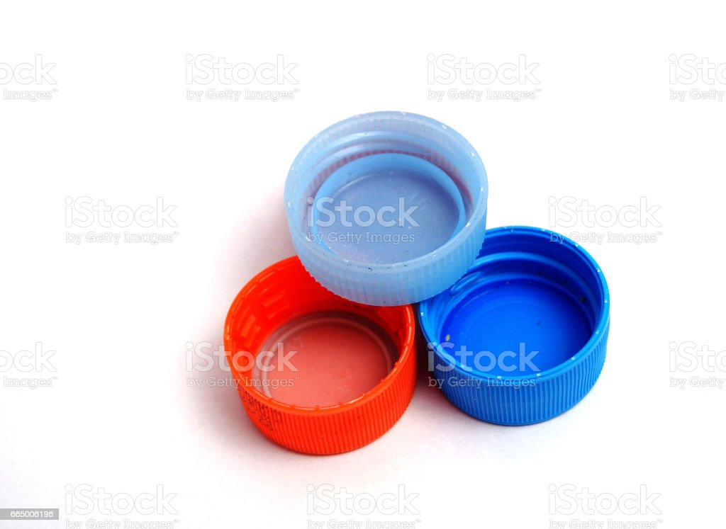 Plastic bottle caps on white background. selective focus stock photo