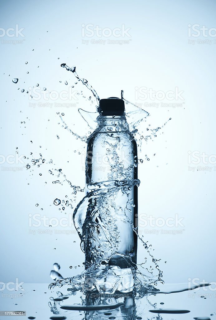 plastic bottle of water and splash around it stock photo