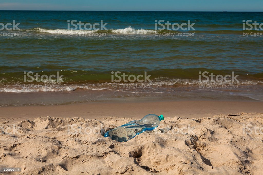 Plastic bottle on  beach stock photo