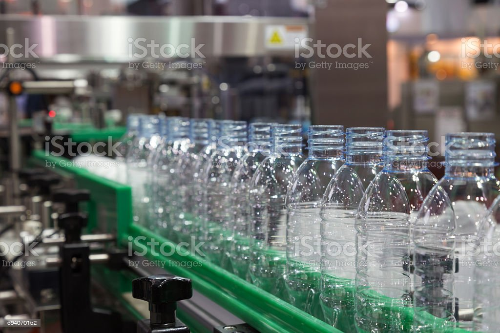 plastic bottle on factory line machine in the factory stock photo