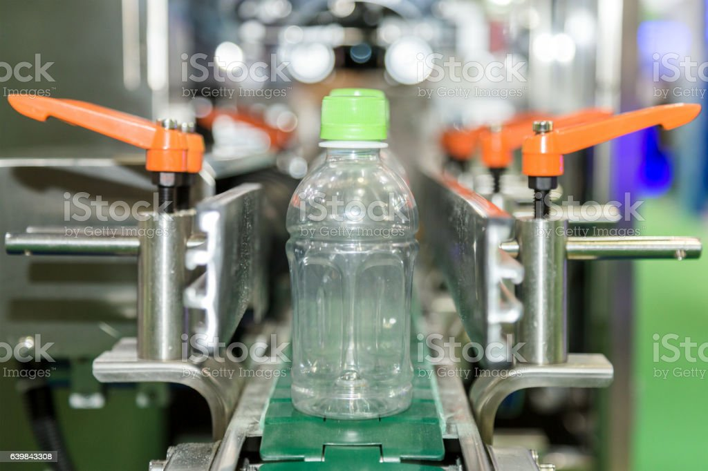 plastic bottle on factory line machine in the factory. stock photo