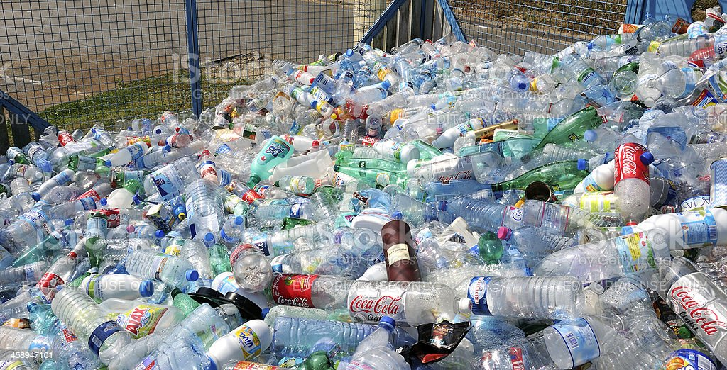 plastic bottles and jugs in recycling center stock photo