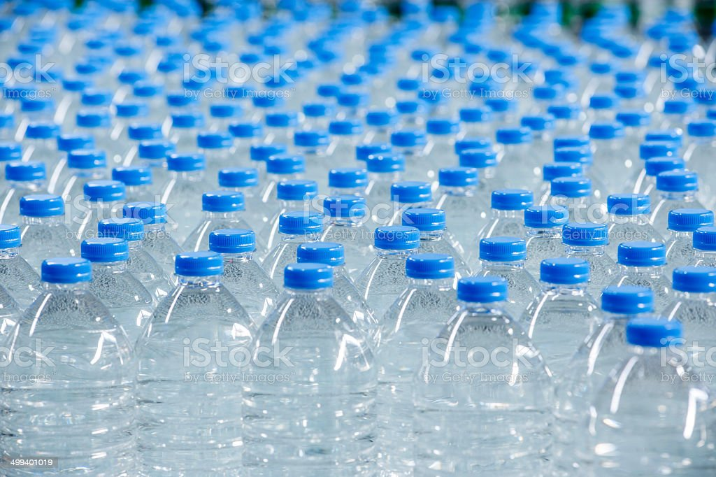 Plastic bottles on conveyor belt stock photo