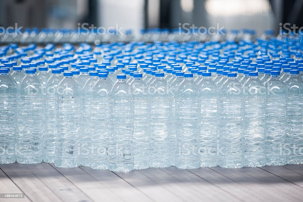 Plastic bottles on conveyor belt stock photo