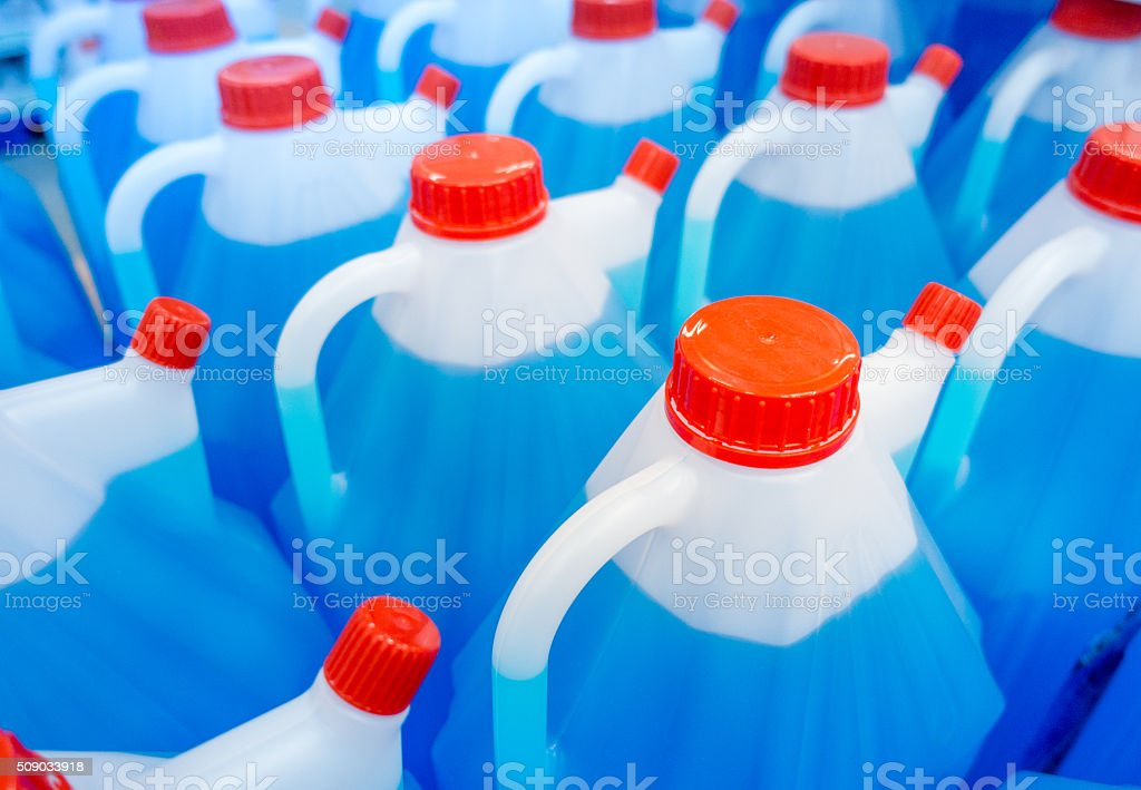 Plastic Bottles with blue non freezing cleaning liquid stock photo