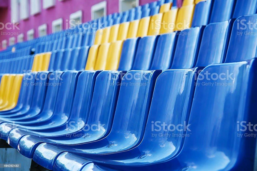plastic chairs at stadium stock photo