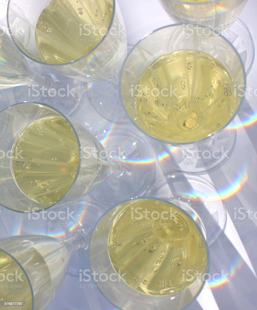 Plastic champagne flutes image / sparkling wine glasses at wedding reception stock photo