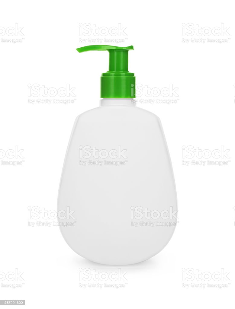 Plastic clean white bottle with green dispenser pump stock photo