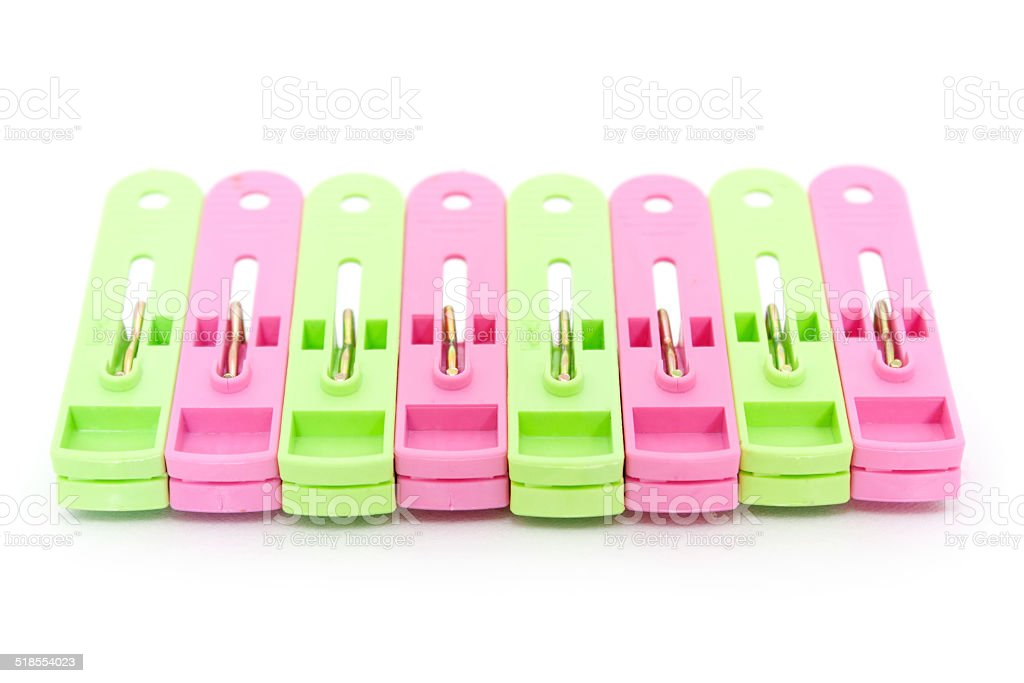 Plastic clothes pegs over white background stock photo