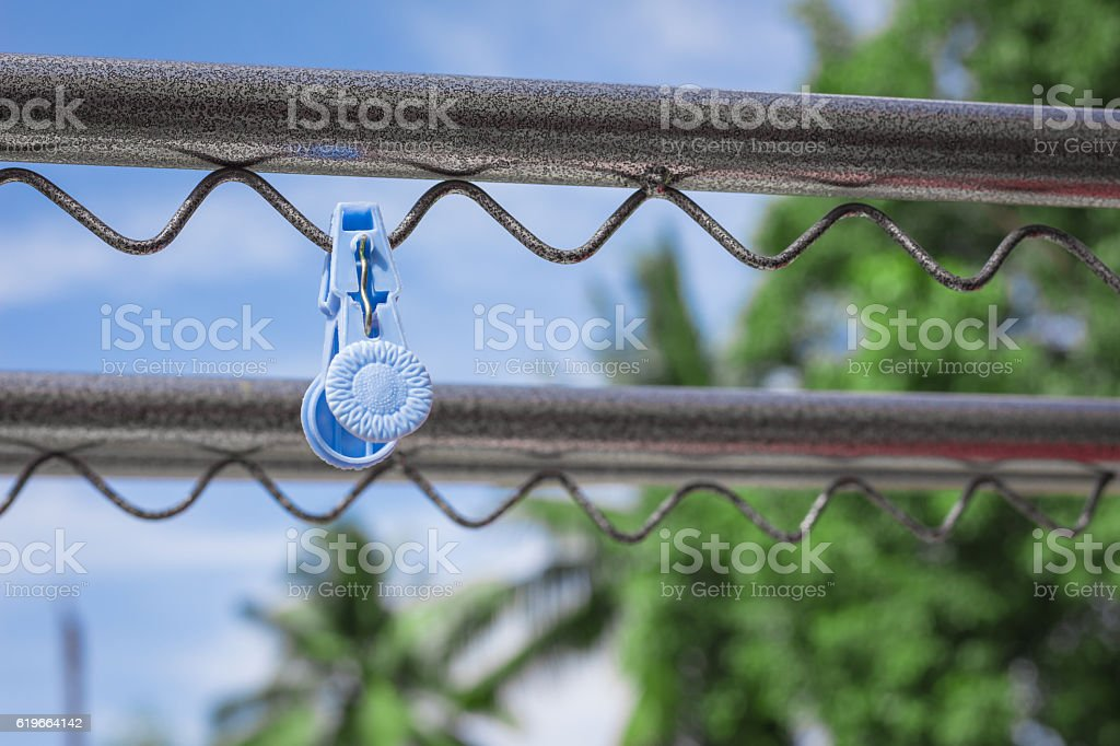 Plastic clothespin on a clothesline. stock photo
