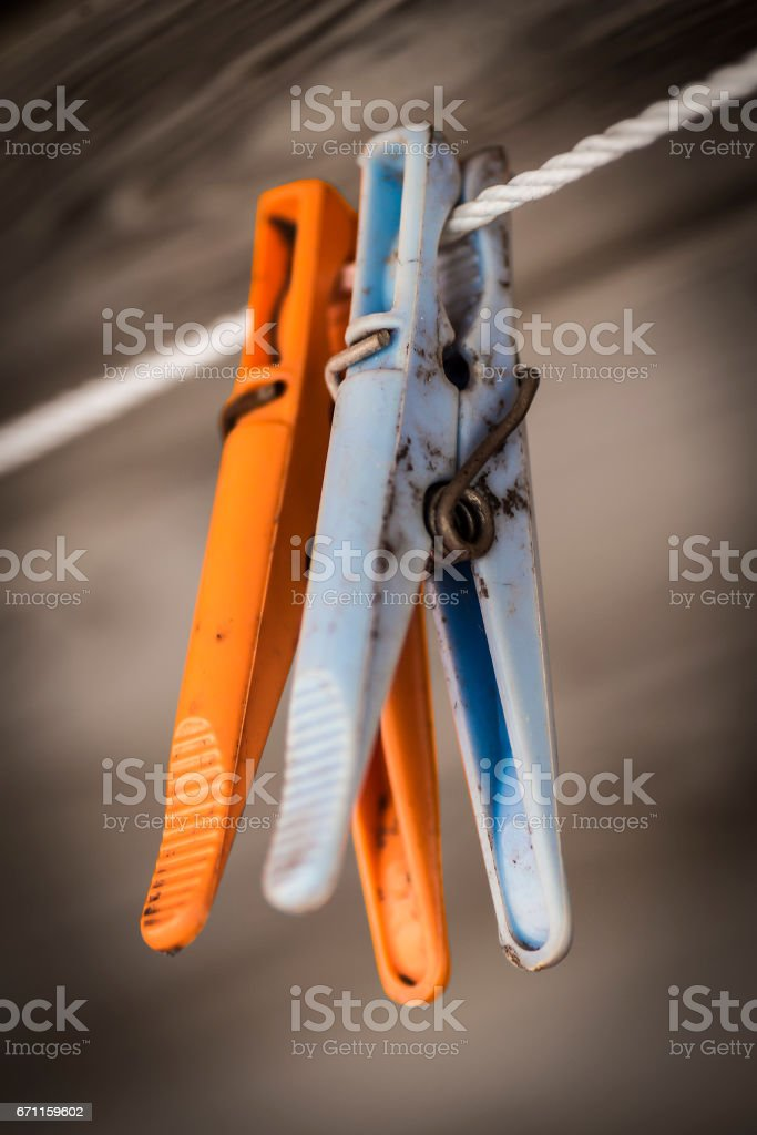 Plastic colored clothes pegs stock photo