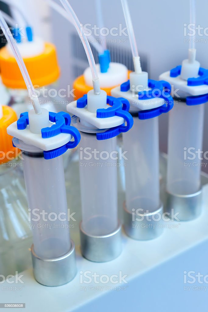 Plastic containers with members of their thin tubes. stock photo