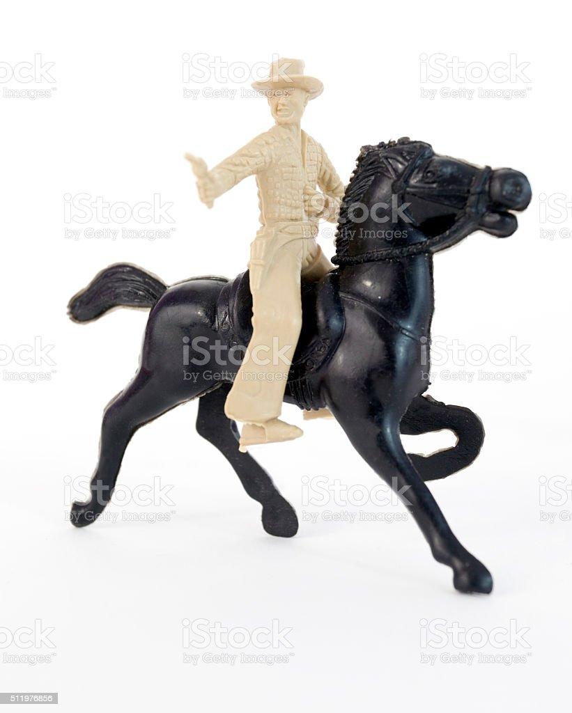 Plastic Cowboy on Horse stock photo