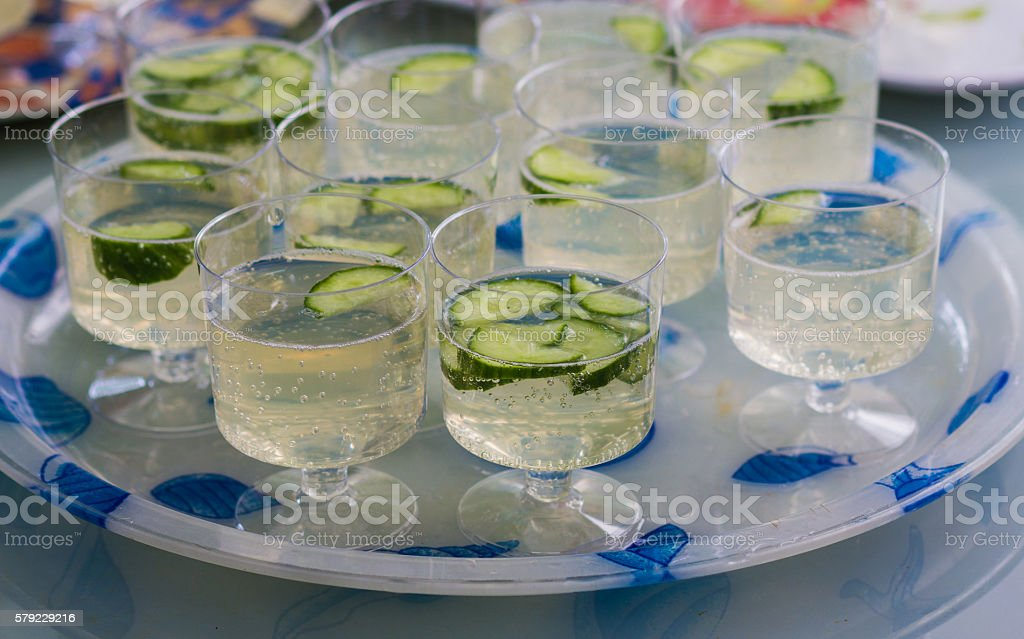 Plastic cups cooled refresh of water and cucumbers stock photo