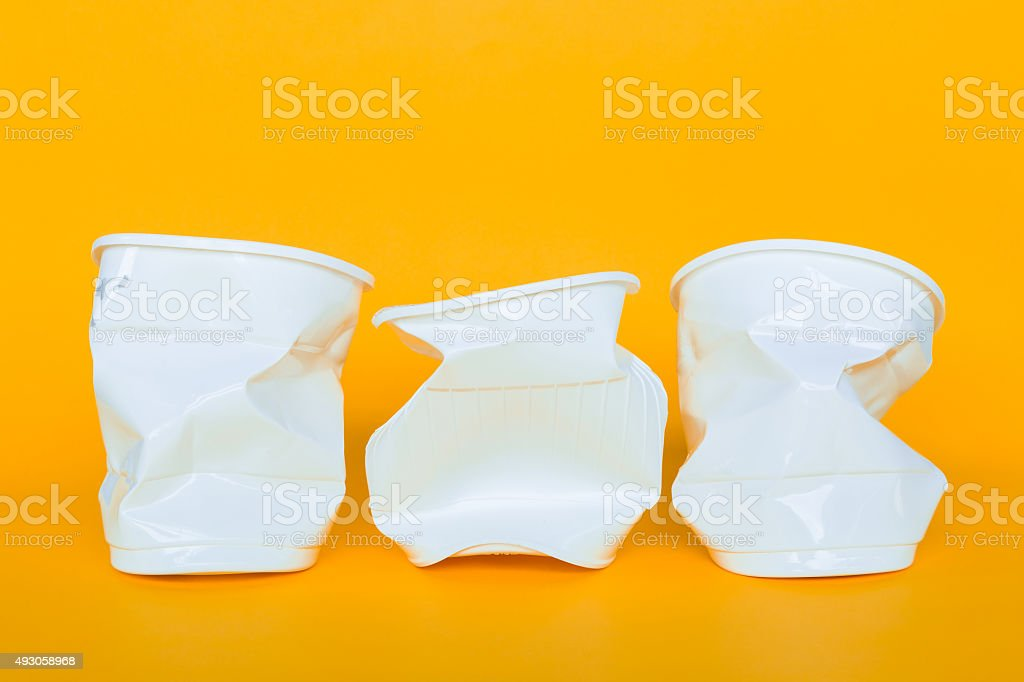 Plastic cups into the garbage stock photo