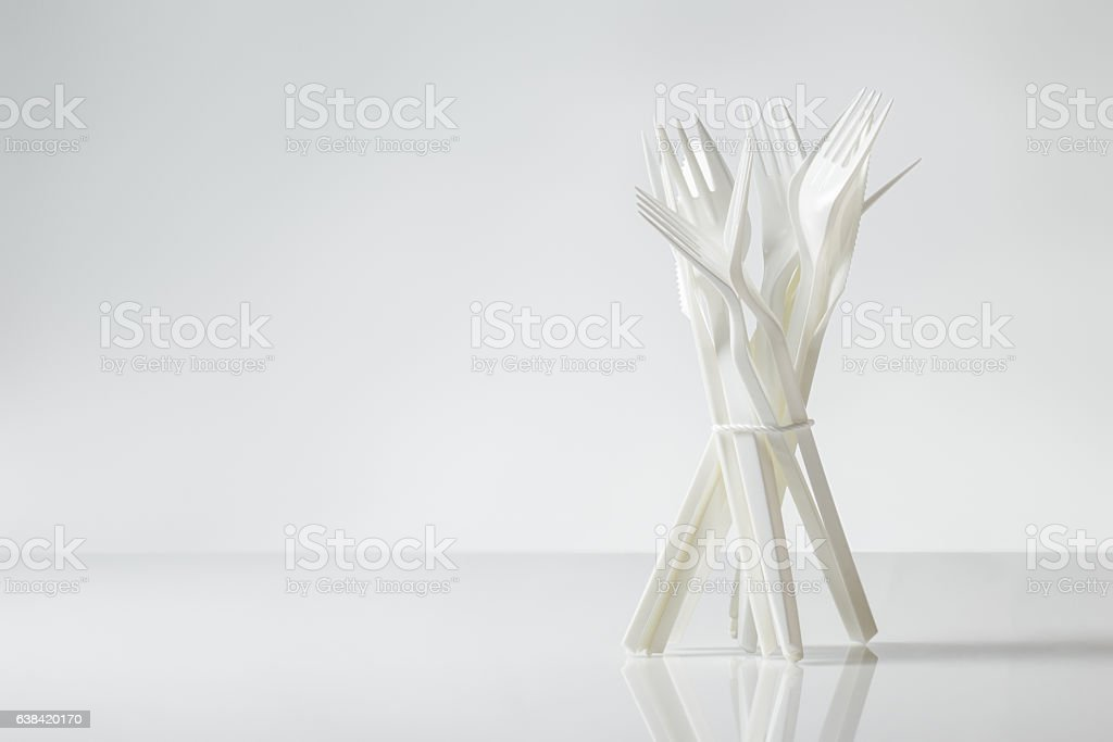 plastic cutlery on white stock photo