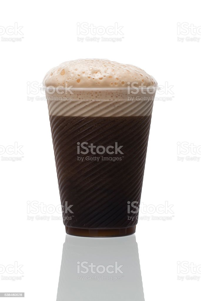 Plastic disposable cup of home made dark beer. stock photo