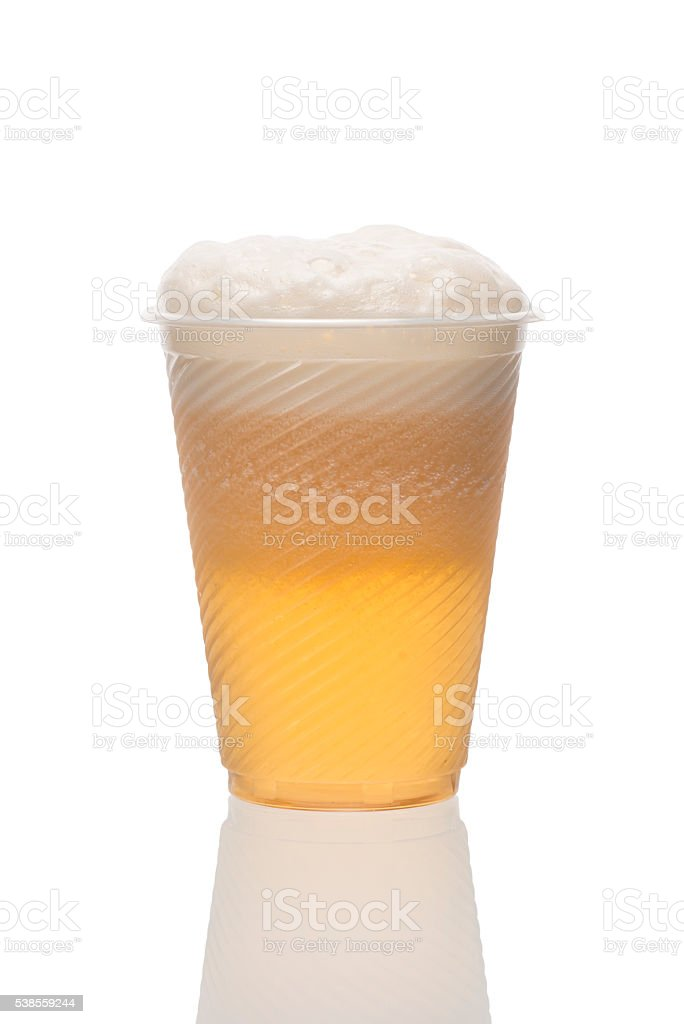 Plastic disposable cup of lager beer. Home brewing. stock photo