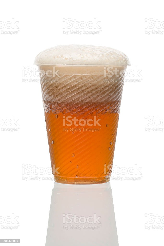 Plastic disposable cup of red beer. Home brewing. stock photo