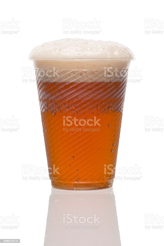 Plastic disposable cup of red lager beer. Home brewing. stock photo