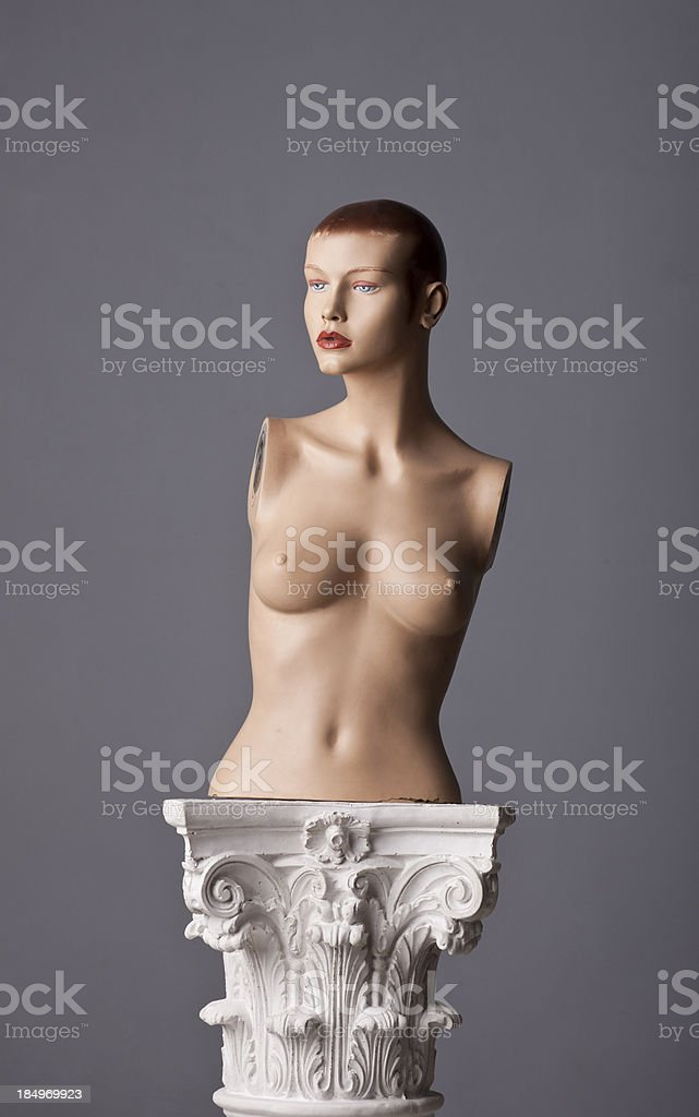 plastic dummy woman on a corinthian capital royalty-free stock photo