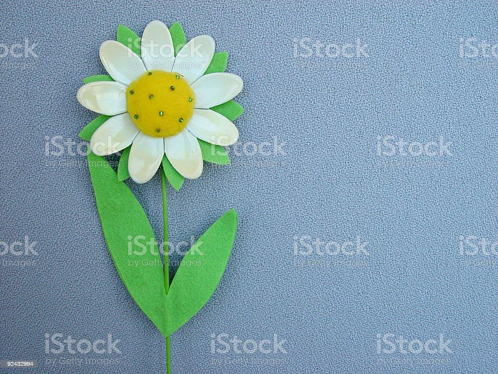 Plastic Flower on Grey Background royalty-free stock photo