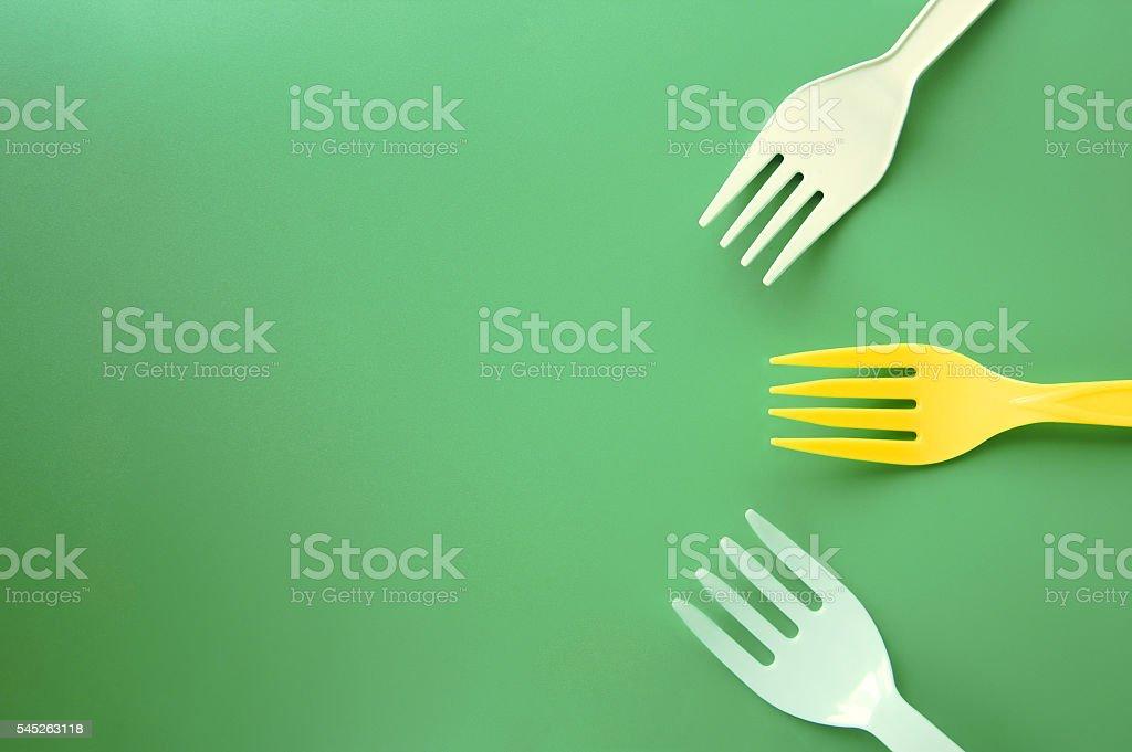Plastic forks appearing to come together foto de stock libre de derechos