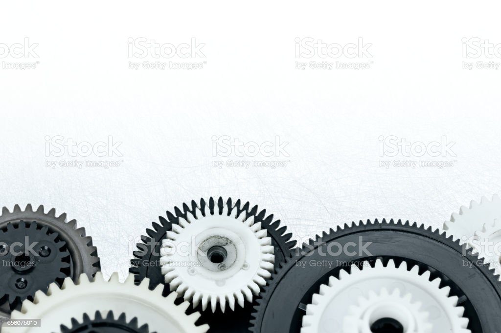 plastic gear cogwheels on industrial metal background stock photo