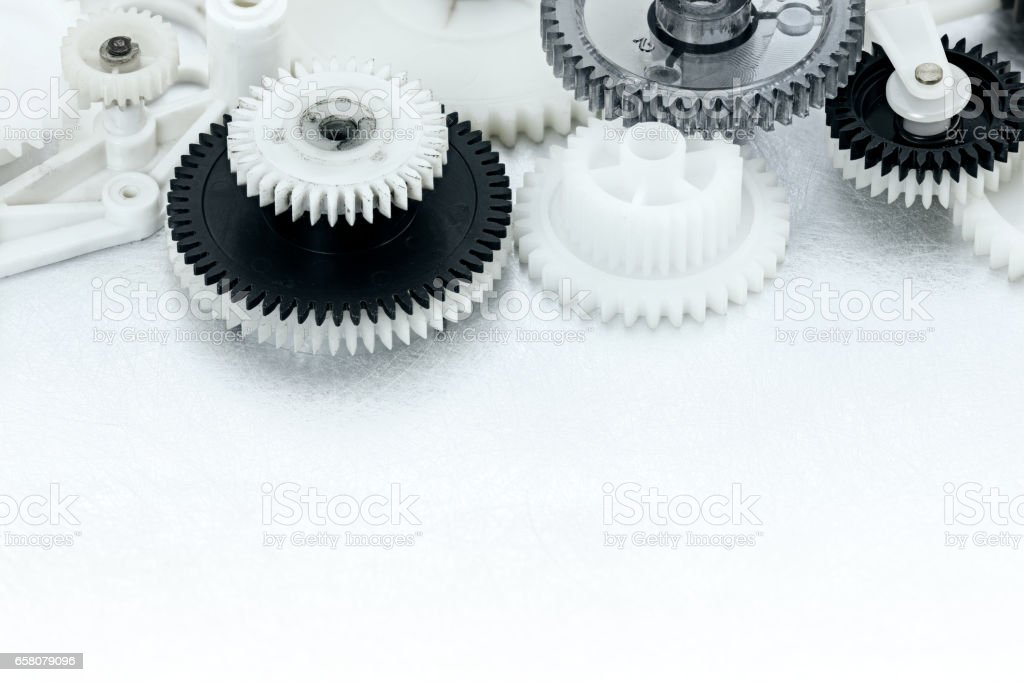 plastic gear cogwheels on industrial scratched background stock photo
