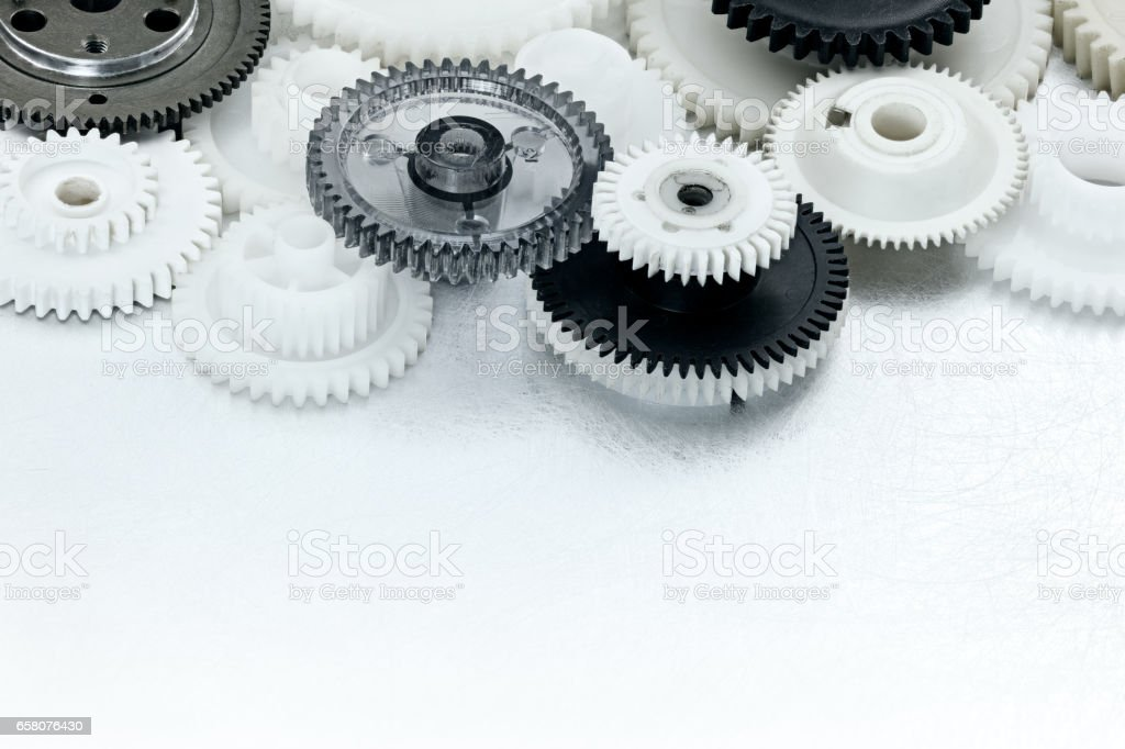 plastic gear cogwheels on scratched industrial background stock photo