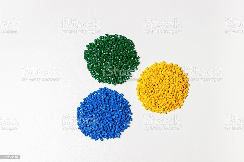 Plastic granules. Polymeric dye. Colorant pellets. stock photo