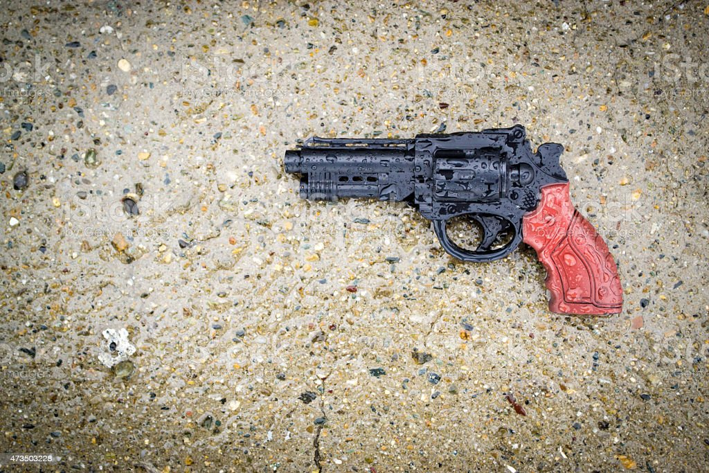Plastic Gun in Rain stock photo