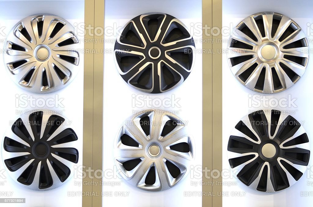 Plastic hubcaps on the wheels stock photo