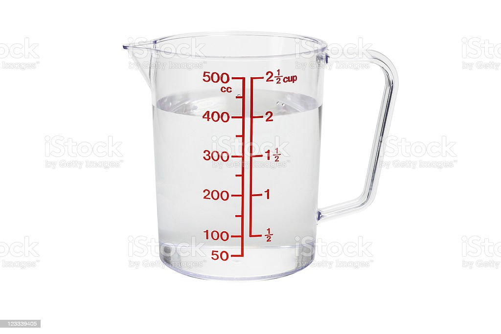 Plastic kitchen measuring cup filled with water stock photo