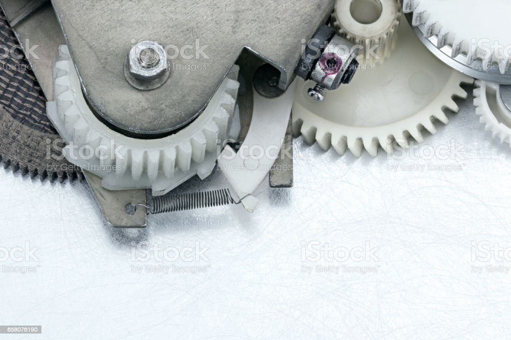 plastic machinery gear cogwheels on scratched background stock photo