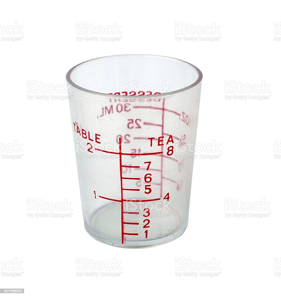 Plastic measuring cup, isolate on white background stock photo