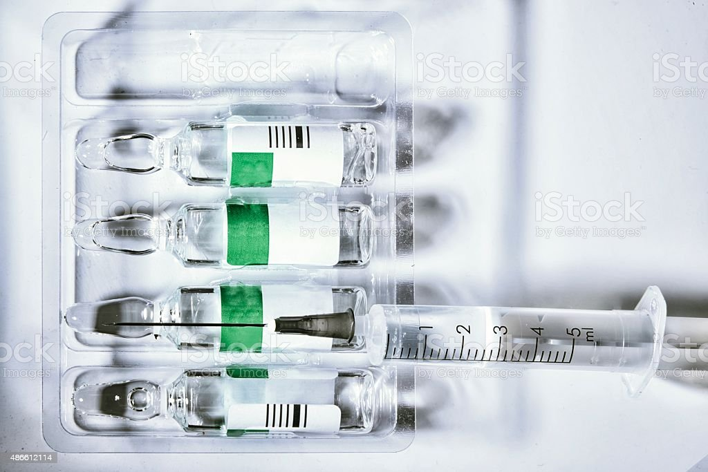 plastic medical syringe and ampoule stock photo